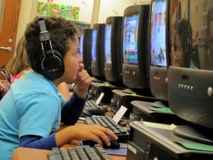 kid-with-headphones-testing